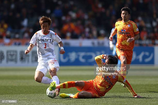 Mutsumi Tamabayashi of Ehime FC and Tomoya Inukai of Shimizu SPulse compete for the ball during the JLeague second division match between Shimizu...