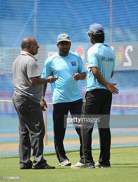 Muttiah Muralitharan and Kumar Sangakkara of Sri Lanka have a chat with former player Aravinda Da Silva during the Sri Lanka nets session at the...