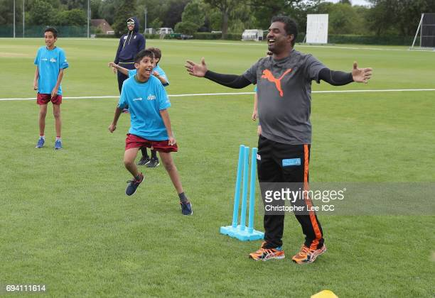 Muttiah Muralitharan celebrates taking the winning wicket as he plays a cricket game with kids from a local school during the ICC Cricket For Good...