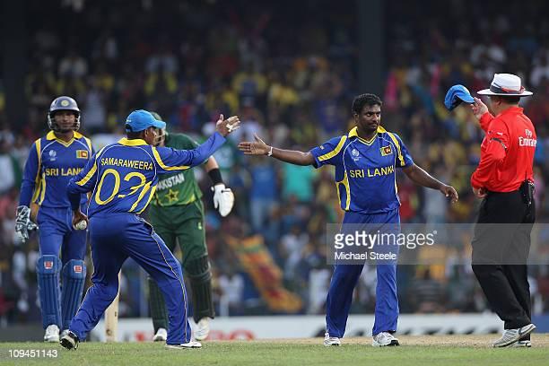 Muttiah Muralitharan high fives with Thilan Samaraweera during the Pakistan v Sri Lanka 2011 ICC World Cup Group A match at the R Premadasa Stadium...