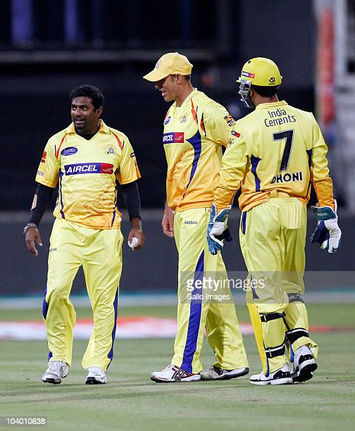 Muttiah Muralitharan Matthew Hayden and MS Dhoni of the Chennai Super Kings discuss tactics during the Airtel Champions League Twenty20 match between...