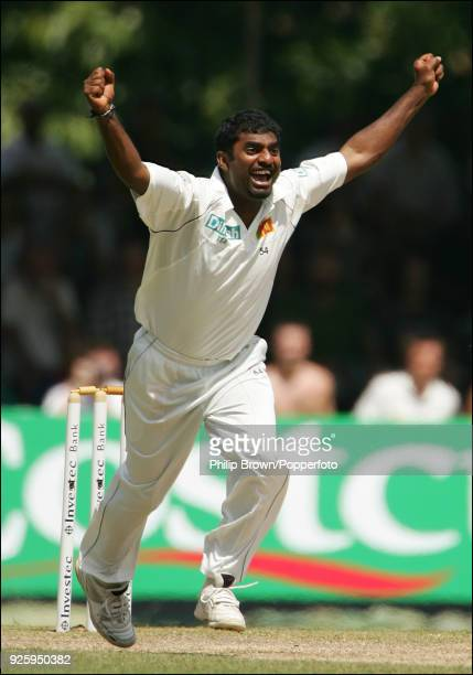 Muttiah Muralitharan of Sri Lanka celebrates after getting the wicket of England batsman Paul Collingwood , taking him to a record 709 Test wickets,...