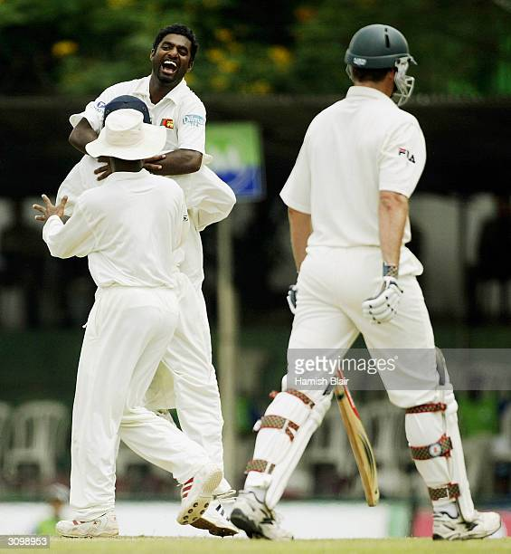 Muttiah Muralitharan of Sri Lanka celebrates his 500th career wicket as he dismisses Michael Kasprowicz of Australia during day one of the Second...