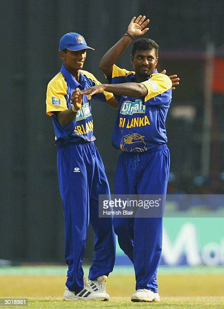 Muttiah Muralitharan of Sri Lanka celebrates the wicket of Andrew Symonds of Australia during the One Day International between Sri Lanka and...