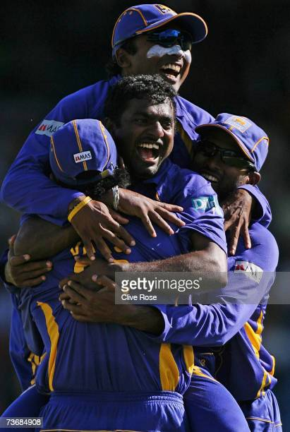 Muttiah Muralitharan of Sri Lanka celebrates the wicket of Mahendra Dhoni of India during the ICC Cricket World Cup 2007 Group B match between India...