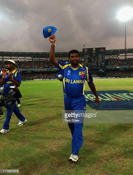 Muttiah Muralitharan of Sri Lanka leaves the field for the last time in Sri Lanka during the 2011 ICC World Cup Semi-Final match between New Zealand...
