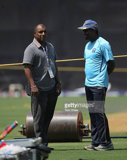 Muttiah Muralitharan of Sri Lankahas a chat with former player Aravinda Da Silva during the Sri Lanka nets session at the Wankhede Stadium on March...