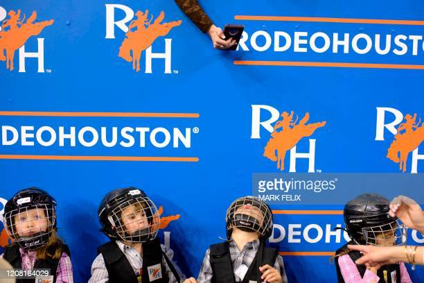 Mutton Bustin' participants are photographed while waiting in line before having their turn to ride during the Houston Livestock Show and Rodeo on...