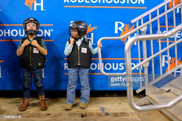 Mutton Bustin' participants Burke Wilson and Camden Kochran wait in line before having their turn to ride during the Houston Livestock Show and Rodeo...