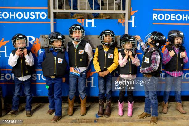 Mutton Bustin' participants wait in line before having their turn to ride during the Houston Livestock Show and Rodeo on March 6, 2020 in Houston,...
