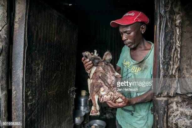 Mutual Mutune prepares soups to sell in Kibera slum on March 12 2018 in Nairobi Kibera is located 6KM south west of the city centre of Nairobi the...