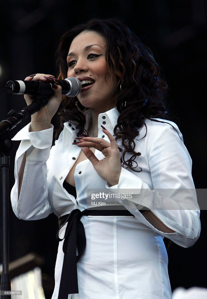 Mutya from Sugababes performs on stage at the Live 8 Edinburgh concert at Murrayfield Stadium on July 6, 2005 in Edinburgh, Scotland. The free gig, labelled Edinburgh 50,000 - The Final Push, is organised by Midge Ure, alongside Geldof, and coincides with the G8 summit to raisie awareness for MAKEpovertyHISTORY.