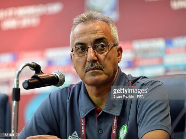 Muwafaq Adlool head coach of Iraq looks on during the press conference of the Iraq U17 team at the Khalifa Bin Zayed Stadium on October 17 2013 in Al...