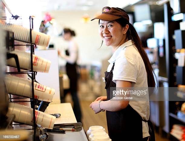 Muyi Wu works at the Dunkin' Donuts on Southern Artery in Quincy the original Dunkin' Donuts store