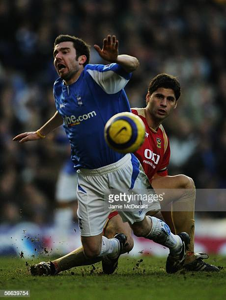 Muzzey Izzet of Birmingham City is tackled by Dejan Stefanovic of Portsmouth during the Barclays Premiership match between Birmingham City and...