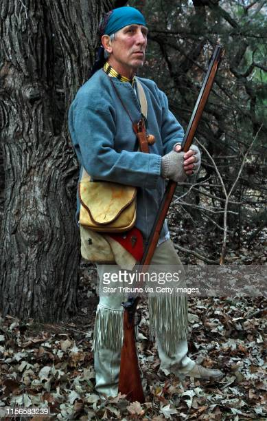 Muzzleloader enthusiast Jim Townsend of Andover dressed in 1800's hunting clothing carrying a southern mountain rifle MARLIN LEVISON/STARTRIBUNE