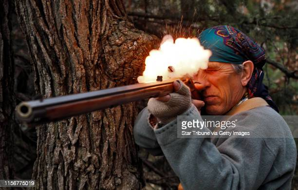 Muzzleloader enthusiast Jim Townsend of Andover firing a model of early 1800's southern mountain rifle MARLIN LEVISON/STARTRIBUNE