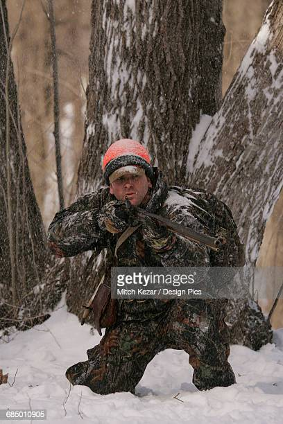 Muzzleloader hunter deer hunting in winter
