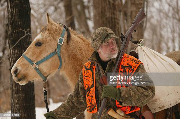 Muzzleloader Hunter With Horse Hunting In Winter