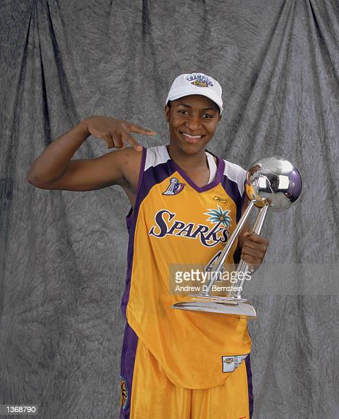Mwadi Mabika of the Los Angeles Sparks poses for a studio portrait with the WNBA Championship Trophy after winning the 2002 WNBA Finals against the...