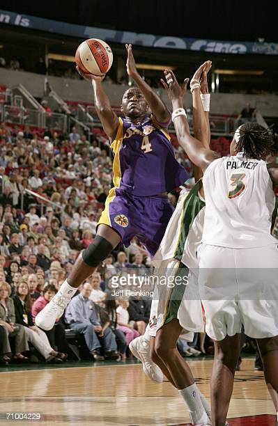 Mwadi Mabika of the Los Angeles Sparks shoots over the defense of Wendy Palmer of the Seattle Storm on May 21, 2006 at Key Arena in Seattle,...