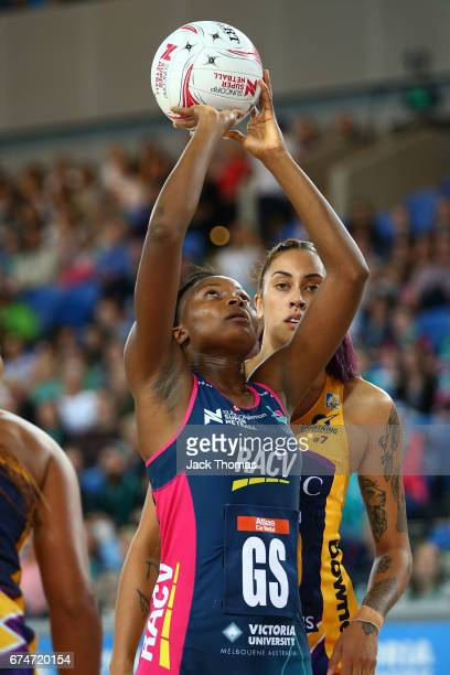 Mwah Kumwenda of the Melbourne Vixens shoots during the round 10 Super Netball match between the Vixens and the Lightning at Margaret Court Arena on...