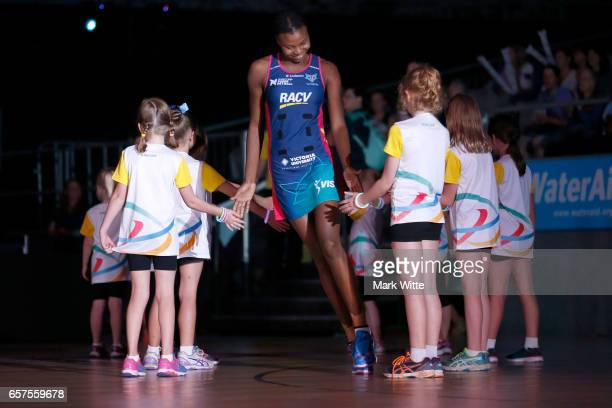 Mwai Kumwenda of Melbourne Vixens runs out onto court before the round six Super Netball match between the Vixens and the Giants at Hisense Arena on...