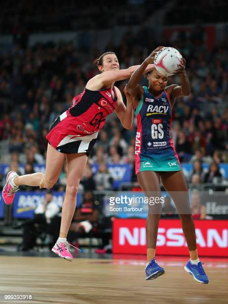 Mwai Kumwenda of the Vixens and Kate Shimmin of the Thunderbirds compete for the ball during the round 11 Super Netball match between the Vixens and...