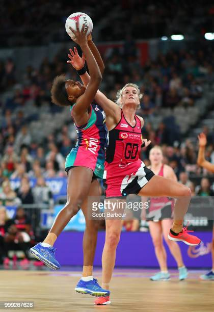 Mwai Kumwenda of the Vixens and Leana de Bruin of the Thunderbirds compete for the ball during the round 11 Super Netball match between the Vixens...