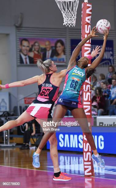 Mwai Kumwenda of the Vixens catches over Leana de Bruin of the Thunderbirds during the round four Super Netball match between the Thunderbirds and...