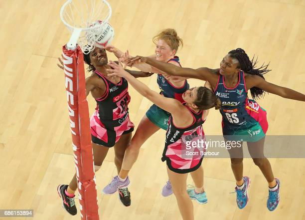 Mwayi Kumwenda and Tegan Philip of the Vixens and Ama Agbeze of the Thunderbirds compete for the ball during the round 13 Super Netball match between...