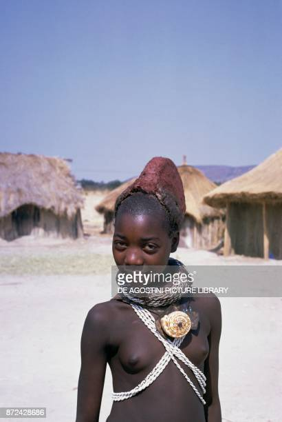 Mwila young girl with the traditional mohawk hairstyle for the puberty ceremony Angola South Africa