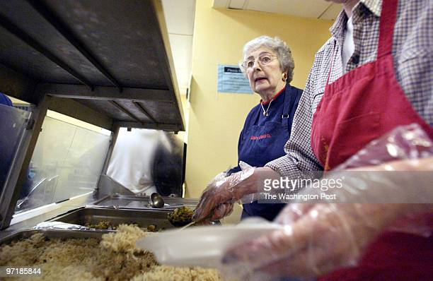 mxflavor27 111903 Mark Gail_TWP Jeanne Mc Coy waits for Melissa Middleton to spoon a serving of rice on a plate to be served at dinner at the...