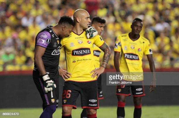 Máximo Banguera goalkeeper of Barcelona SC and his teammate Ariel Nahuelpan look ofjected after losing a first leg match between Barcelona SC and...