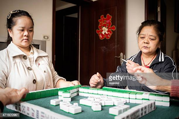my aunt and sister - mahjong stock photos and pictures