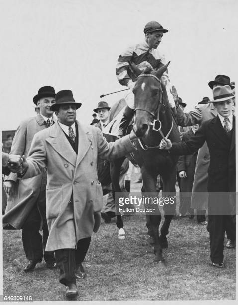 My Babu ridden by Charlie Smirke is led in by the Maharajah of Baroda after winning the 2000 Guineas at Newmarket