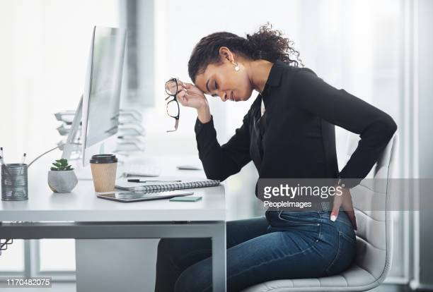 my back pain is just adding to my stress - lower back stock pictures, royalty-free photos & images