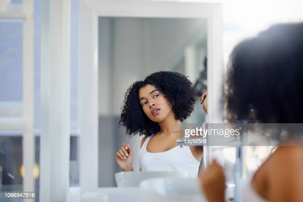 my beauty regimen is totally doable and affordable - curly stock pictures, royalty-free photos & images