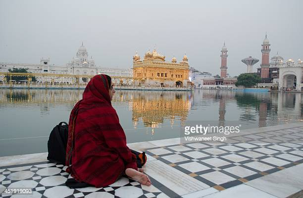 """My better half sitting at the """"parikarma"""" of the Golden Temple listening to the music of the """"Kirtan"""" .She was trying to sing along it was the..."""