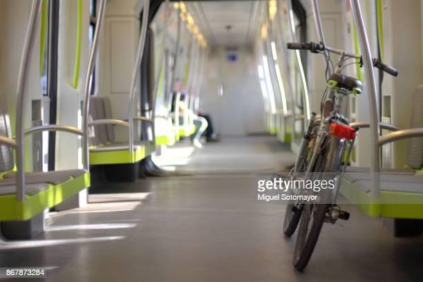 my bicycle in the train - valencia fotografías e imágenes de stock