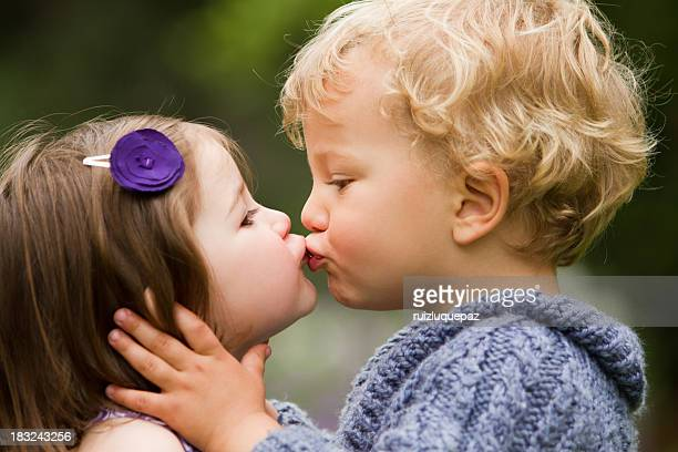 my first kiss - very young girls stock photos and pictures