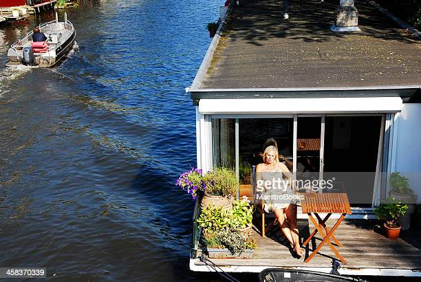 my floating terrace. - houseboat stock pictures, royalty-free photos & images