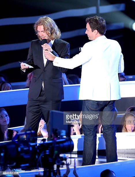 My Friend's Place representative Jesse accepts Video of the Year for 'Wrecking Ball' from TV personality Jimmy Fallon onstage during the 2014 MTV...