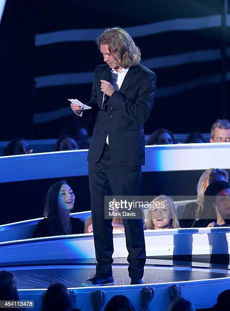 My Friend's Place representative Jesse accepts Video of the Year for 'Wrecking Ball' onstage during the 2014 MTV Video Music Awards at The Forum on...