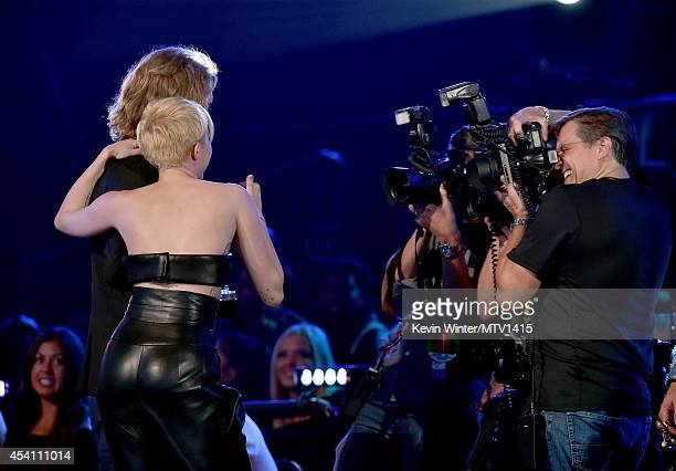 My Friend's Place representative Jesse Helt accepts Video of the Year with singer Miley Cyrus for 'Wrecking Ball' onstage during the 2014 MTV Video...