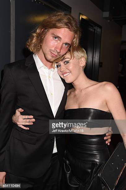 My Friend's Place representative Jesse Helt and recording artist Miley Cyrus attends the 2014 MTV Video Music Awards at The Forum on August 24 2014...