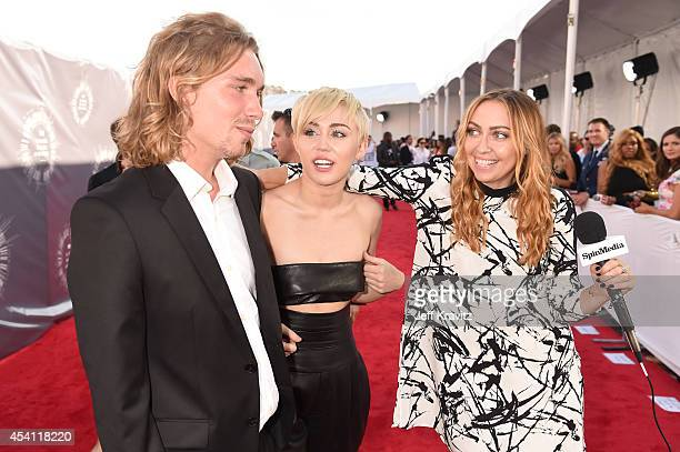 My Friend's Place representative Jesse Helt recording artist Miley Cyrus and actress Brandi Cyrus attends the 2014 MTV Video Music Awards at The...