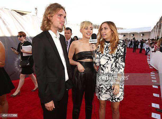 My Friend's Place representative Jesse Helt singer Miley Cyrus and actress Brandi Cyrus attend the 2014 MTV Video Music Awards at The Forum on August...