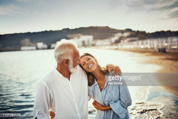 my grandfather is someone with silver in his hair and gold in his heart. - daughter stock pictures, royalty-free photos & images