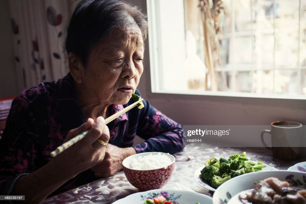 My grandmother at lunch : Stock Photo